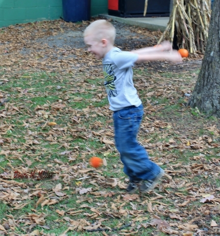 This little fella was so excited to be playing catch with his grandpa he couldn't stand still.